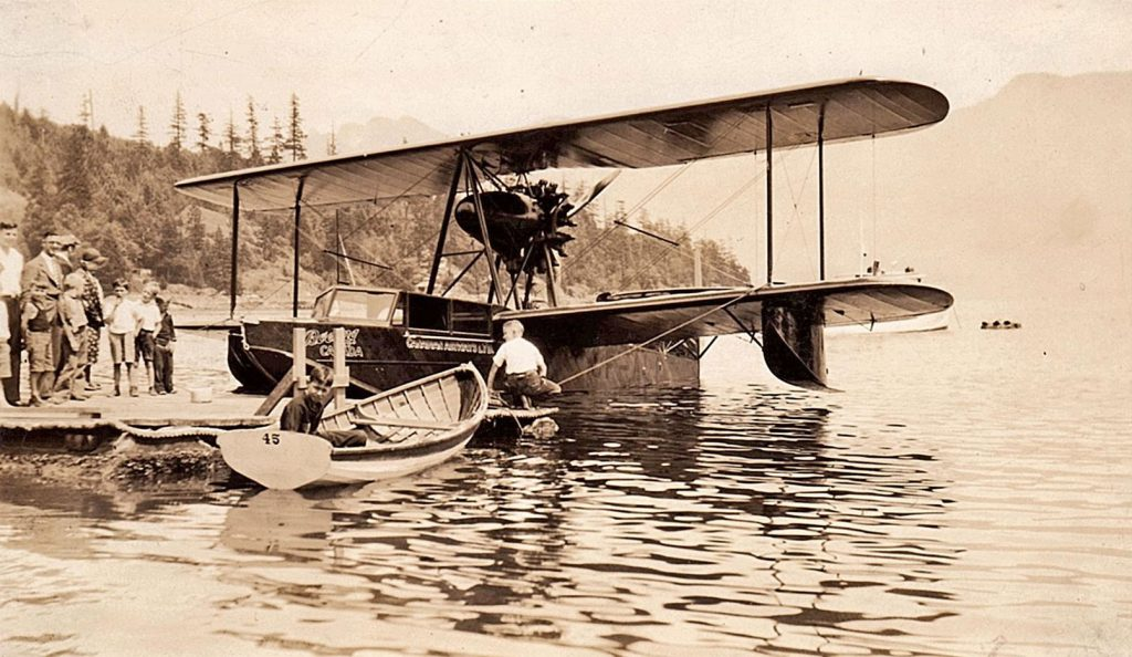 Old fashion biplane on floats at a dock in Mannion Bay